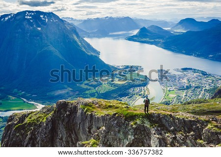 Hiking ROMSDALSEGGEN RIDGE, Andalsnes City, Norway Mountain Landscape - stock photo