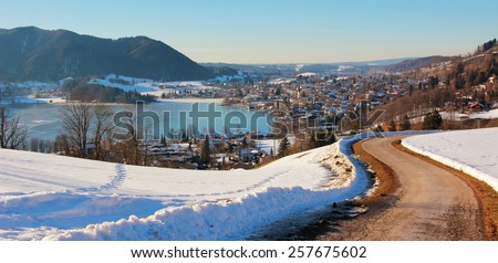 hiking route to spa town schliersee and lake, bavarian winter landscape - stock photo
