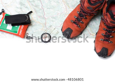 Hiking shoes and equipment on map with compass(clipping path)