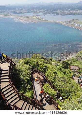 Hiking stairs atSunrise Peak a UNESCO World Heritage, Jeju island, South Korea. Captured on April 30th 2016. - stock photo