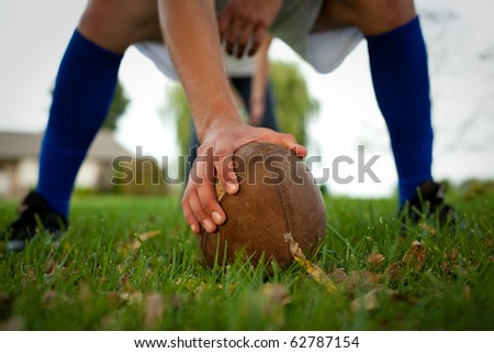 Hiking the football in the backyard.