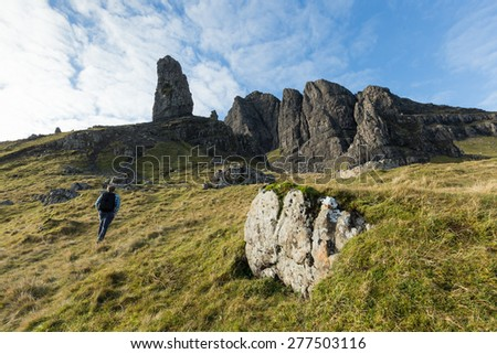 Hiking through Scottish highlands in the Isle of Skye on a clear day, Scotland. - stock photo