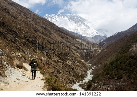 Hiking to South Everest Base Camp in Himalayas,Nepal,one of the most popular trekking routes in the world - stock photo