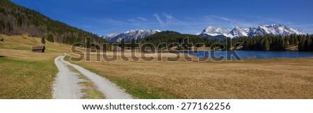 hiking trail around lake geroldsee, panoramic view to karwendel mountains, bavaria - stock photo