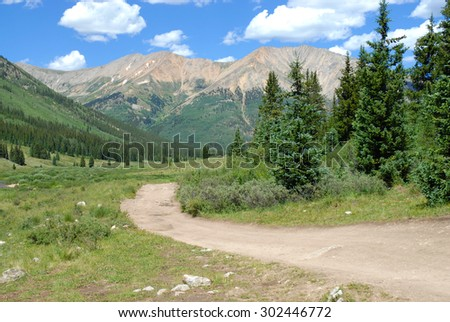 Hiking trail in the Rocky Mountains, American West, USA - stock photo