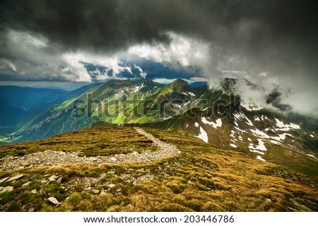 Hiking trail in the Romanian Fagaras mountains in the summer - stock photo
