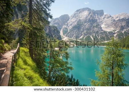 Hiking trail with beautiful panorama at Lake Braies in the Dolomites in South Tyrol, Italy