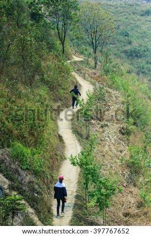 Hiking, trekking, walking in the forest. - stock photo