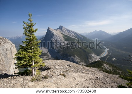 Hiking up East Rundle Mountain. Looking at Ha Ling Peak, Spray Lake Valley, also can be seen is a Water Canal that Transports water from Spray Lake to the town site of Canmore, Alberta, Canada. - stock photo