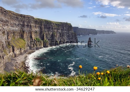 hiking walking trail by sea cliffs and ocean - stock photo
