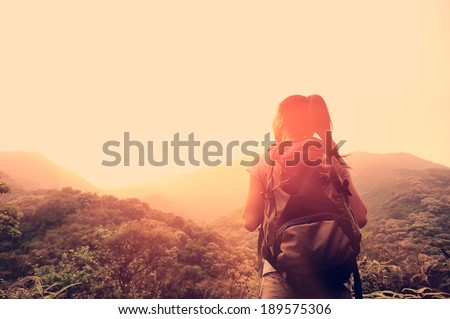 hiking woman enjoy the beautiful view at mountain peak  - stock photo
