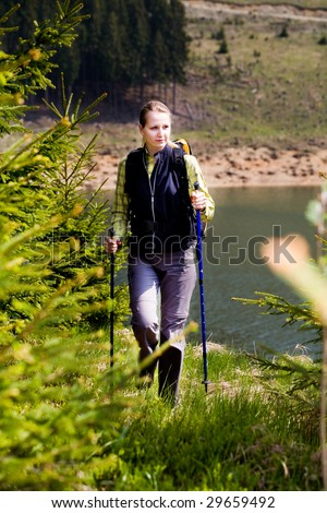 hiking woman in front of wilde nature - stock photo