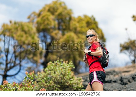Hiking woman in mountains. Fitness and healthy lifestyle outdoors in summer nature, La Palma, Canary Islands - stock photo