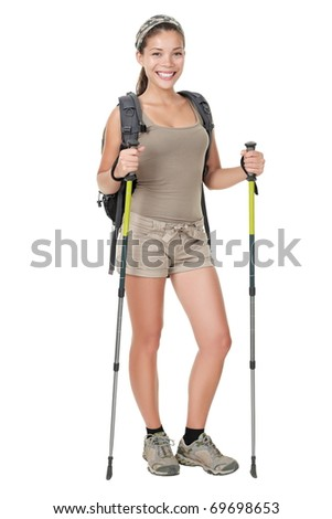 Hiking woman standing isolated. Female hiker with backpacking bag and hiking poles / walking sticks isolated on white background in full length. - stock photo