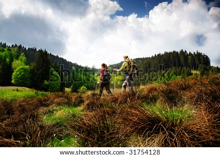 hiking women in front of wilde nature - stock photo