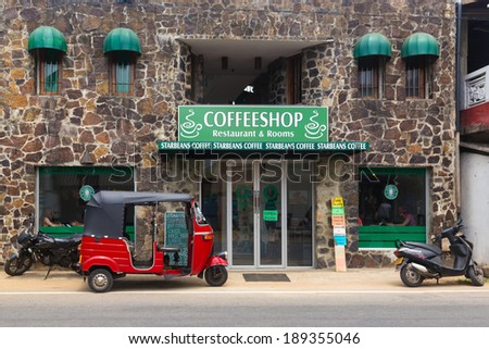 HIKKADUWA, SRI LANKA - FEBRUARY 20, 2014: Red tuk-tuk vehicle parked in front of coffee shop. In Asia, small outlets try to copy big brands, in this case like Starbucks coffee. - stock photo