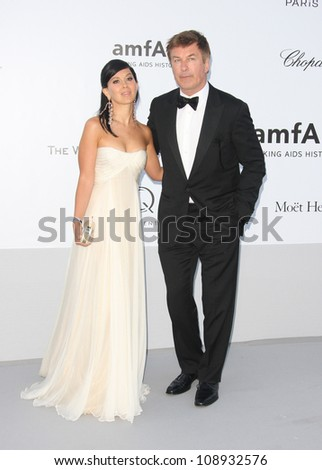 Hilaria Thomas and Alec Baldwin arriving for AmfAR's Cinema Against Aids gala 2012 during the 65th annual Cannes Film Festival Cannes, France - 24.05.12 Henry Harris - stock photo