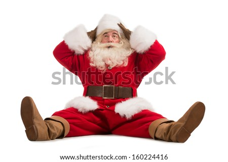 Hilarious and funny Santa Claus confused while sitting on a white background full length - stock photo