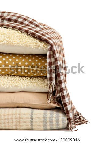 Hill colorful pillows and plaids isolated on white - stock photo