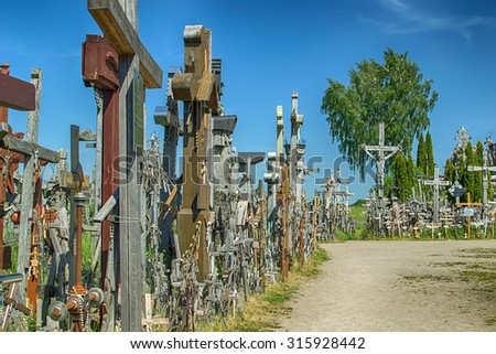 Hill of Crosses in Lithuania next to city of Siauliai in the summer. It is a famous religious site of catholic pilgrimage in northern Lithuania. Beautiful touristic destinations in Baltic states.