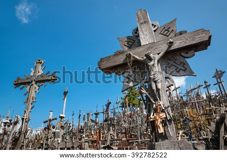 Hill of Crosses is a unique monument of history and religious folk art in Siauliai, Lithuania. Text on the crosses in different languages - O God, protect our family, give health. - stock photo