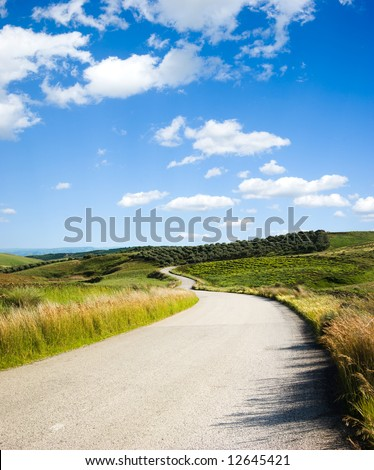 hill road with white cloud - stock photo