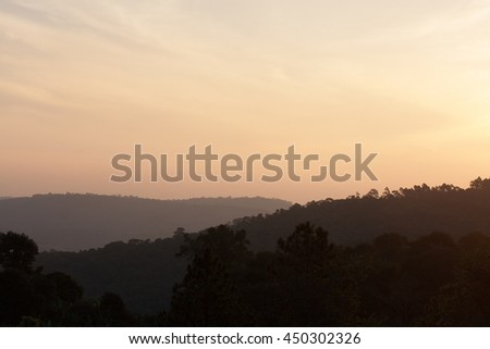 Hills and mountains with sunset light atmosphere - stock photo