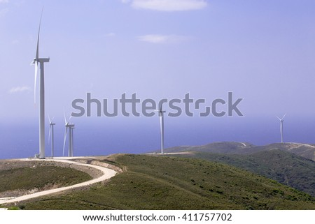 Hills and wind tribunes in the Aegean sea coast.