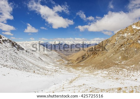 Hills of sand and snow mountain - stock photo