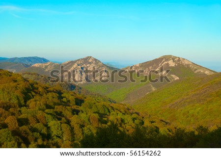 Hills with cloudscape and blue sky. Landscape.