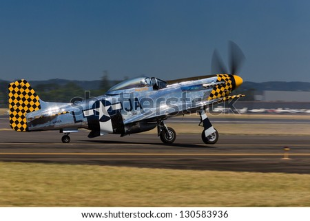 HILLSBORO, OR - AUG 4: Eddie Andreini demonstrates his P-51D Mustang during Oregon Air Show at Hillsboro Airport on August 4, 2012 in Hillsboro, OR. - stock photo