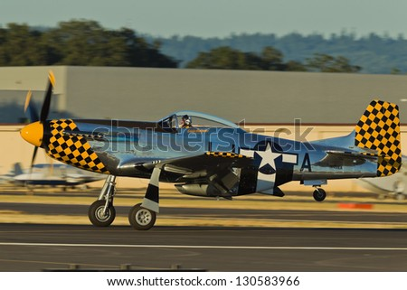 HILLSBORO, OR - AUG 3: Eddie Andreini demonstrates his P-51D Mustang during Oregon Air Show at Hillsboro Airport on August 3, 2012 in Hillsboro, OR. - stock photo