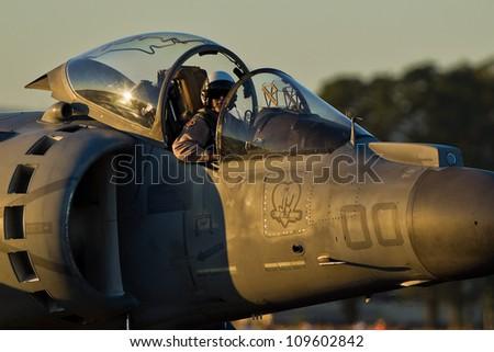 HILLSBORO, OR AUG 3: U.S. Marine Corps AV-8B Harrier II Demonstration Team presents aircraft during Oregon Air Show at Hillsboro Airport on August 3, 2012 in Hillsboro, OR. - stock photo