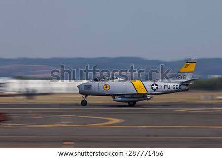 HILLSBORO, OR - SEPT 21: North American F-86F Sabre demonstration by the Bremont Horsemen Aerobatic Team during Oregon International Air Show at Hillsboro Airport on Sept 21, 2014 in Hillsboro, OR.