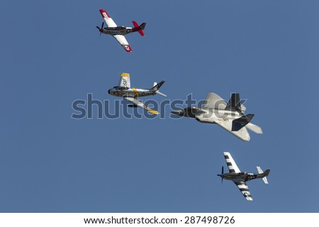 HILLSBORO, OR - SEPT 21: P-51 Mustang WW II, F-86F Sabre and USAF F-22 Raptor aircrafts perform heritage flight during Oregon International Air Show on September 21, 2014 in Hillsboro, OR. - stock photo