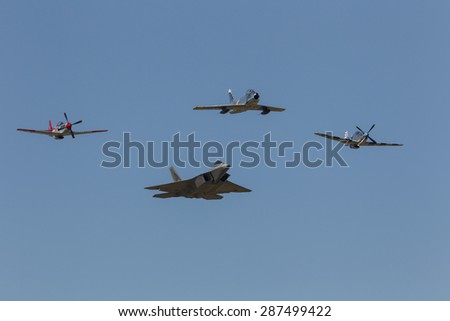 HILLSBORO, OR - SEPT 20: P-51 Mustang WW II, N. American F-86F Sabre and USAF F-22 Raptor aircrafts perform heritage flight during Oregon International Air Show on Sept 20, 2014 in Hillsboro, OR.  - stock photo