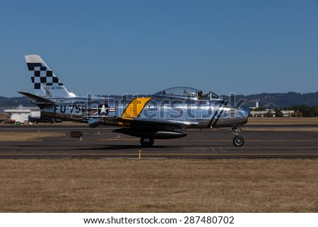 HILLSBORO, OR - SEPT 20: P-51 North American F-86F Sabre demonstration during Oregon International Air Show at Hillsboro Airport on September 20, 2014 in Hillsboro, OR.  - stock photo