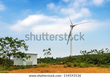 Hillside wind turbines and engine room - stock photo