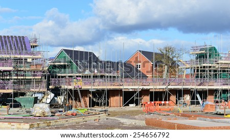 HILPERTON - FEB 21: View of a building site on Feb 21, 2015 in Hilperton, UK. The Wiltshire village is part of the UK's construction boom with the number of new homes being built up 10% since 2013. - stock photo