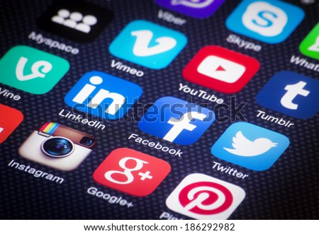 HILVERSUM, NETHERLANDS - APRIL 03, 2014: Social media are trending and both business as consumer are using it for information sharing and networking. Showing social media icons on smartphone. - stock photo