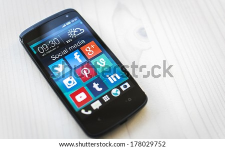HILVERSUM, NETHERLANDS - FEBRUARY 21, 2014: Social media are trending and both business as consumer are using it for information sharing and networking. - stock photo