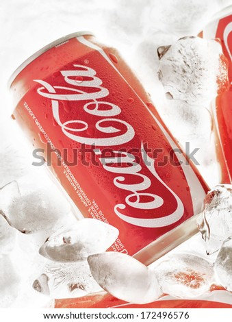 HILVERSUM, NETHERLANDS - JANUARY 19, 2014: Coca-Cola is a carbonated soft drink sold in stores, restaurants, and vending machines worldwide. It is produced by The Coca-Cola Company of Atlanta, Georgia - stock photo