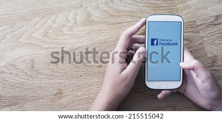 HILVERSUM, NETHERLANDS - JANUARY 30, 2014: Facebook is an online social networking service founded in February 2004 by Mark Zuckerberg with his college roommates and is now a fortune 500 company. - stock photo