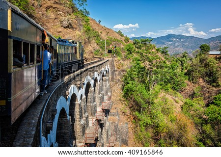HIMACHAL PRADESH, INDIA - MAY 12, 2010: Toy train of Kalka-Shimla Railway - narrow gauge railway built in 1898 and famous for its scenery and improbable construction. It is UNESCO World Heritage Site