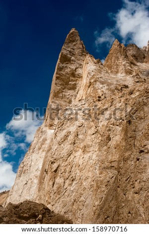 Himalaya high mountains landscape. Rocks and sand formation at Sarchu Plain. India, Ladakh, Sarchu Plain, Manali-Leh highway view, altitude 4300 m - stock photo