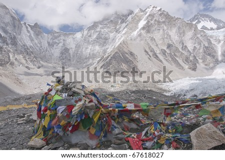HIMALAYA MOUNTAINS, NEPAL - MAY 16: Buddhist Prayer Flags on May 16, 2010 at Everest Base Camp 5364 Metre up in the Himalaya Mountains of Nepal - stock photo