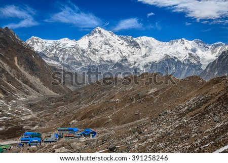 Himalayan landscape at sunny day. View to Gokyo and mount Cho Oyu. Himalayas. - stock photo