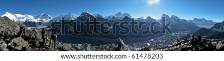 HIMALAYAN MOUNTAINS, NEPAL - OCTOBER 11: Unidentified people view the Himalayan mountains from Gokyo peak, Everest region, Nepal on October 11, 2008. - stock photo