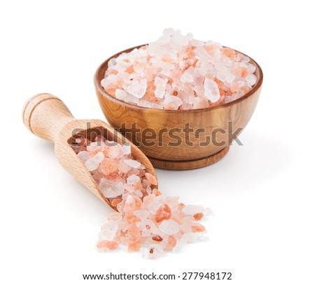 Himalayan pink salt in a wooden bowl isolated on white background - stock photo