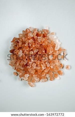 Himalayan pink salt on white background. - stock photo